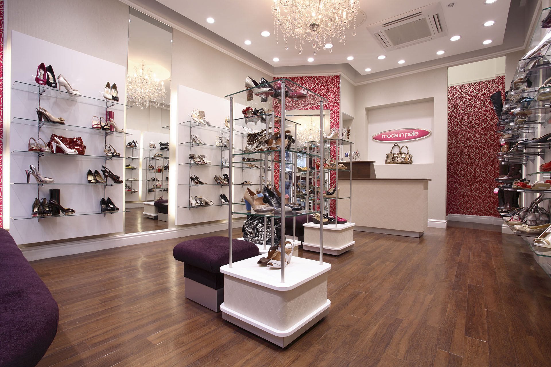 Moda In Pelle - showroom displaying a variety of shoes and bags.